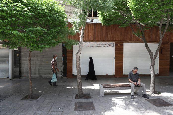 2021-04-10T142826Z_1672883000_RC22TM96S41A_RTRMADP_3_HEALTH-CORONAVIRUS-IRAN-RESTRICTIONS-scaled