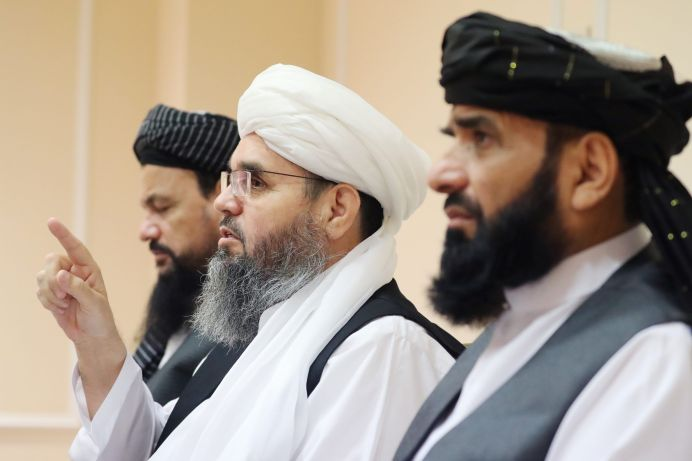 MOSCOW, RUSSIA - JULY 9, 2021: Latif Mansur, Shahabuddin Delavar, and Suhail Shaheen (L-R) of Taliban's political office (banned in Russia) during a press conference at Radisson Hotel. Sergei Savostyanov/REUTERS./