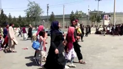 People gather outside Kabul airport, Afghanistan August 16, 2021, in this still image taken from a video. REUTERS.