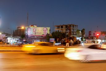 Cars drive past an election campaign poster ahead of the parliamentary election, in Baghdad, Iraq September 27, 2021. Picture taken September 27, 2021. REUTERS/Ahmed Saad
