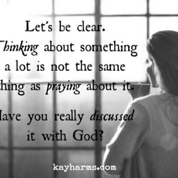 Woman thinking...or praying?