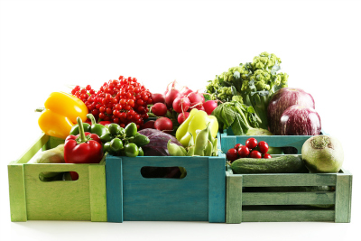 Fresh organic vegetables in wooden boxes, close up