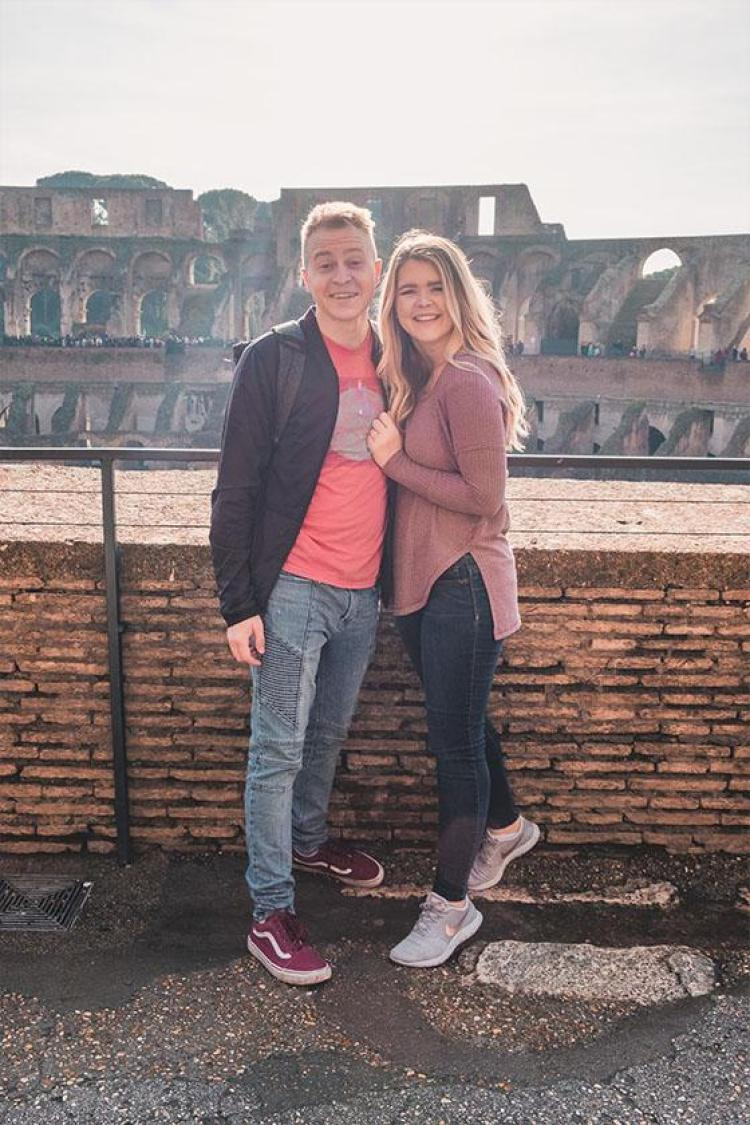 couple at the colosseum in rome italy