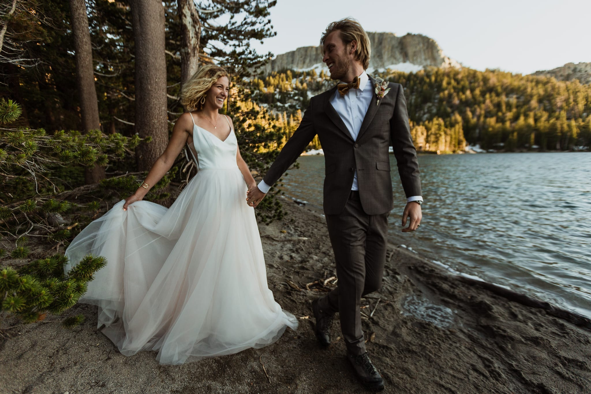 Tyler leads Haylee on their adventure wedding day near the water of McLeod Lake.