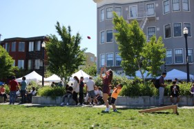 Children and adults play bean bag toss in Patricia's Green during the Hayes Valley Urban Art Fair, on May 1, 2016. (BayNewsNow/Kaylee Fagan)