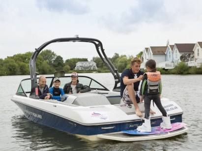 Kids learning to water ski