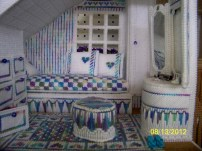 The bedroom, with lovely vanity and detailed bedspread.