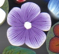 Nice purple flower bead
