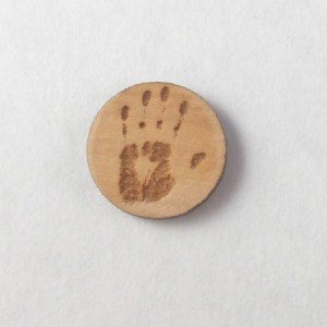 laser-etched handprint earring