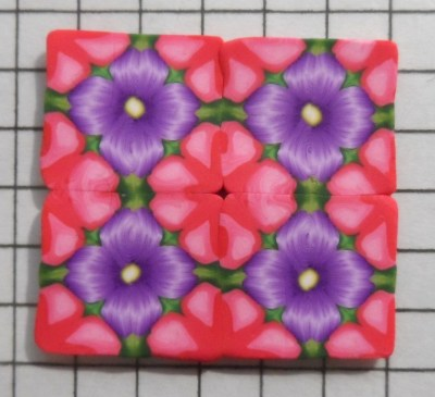 polymer clay kaleidoscope cane experiments - pink and purple flowers