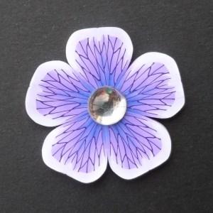 purple polymer clay flower brooch with acrylic cabochon