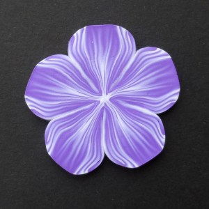 purple polymer clay petunia brooch with acrylic cabochon
