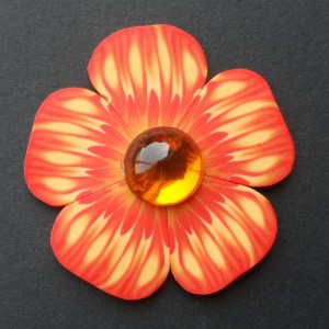 'Fire flower' polymer clay brooch with acrylic cabochon