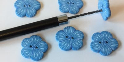 blue and white polymer clay flower button - drill holes