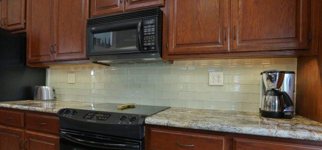 This backsplash: Emser Cream 3 x 6 glass tiles. (Illuminated by LED undercabinet lighting.)