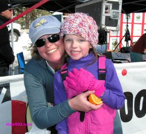Eight-year-old Carissa Wolcott, with proud mom Jamie, won the kids race on snowshoes.