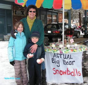 Local Linda Meekins, here with Daisha and Mason, sold her authentic Big Bear snowballs during the Village expo.