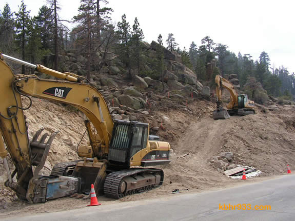Some rocks along the hillside (here, just south of the dam on Highway 18) will be blasted. The first blast took place on May 11.