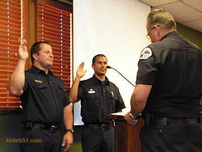 Fire Chief Jeff Willis issues the oath of office to new PCFs David Tharp (left) and Jonathan Bidwell.