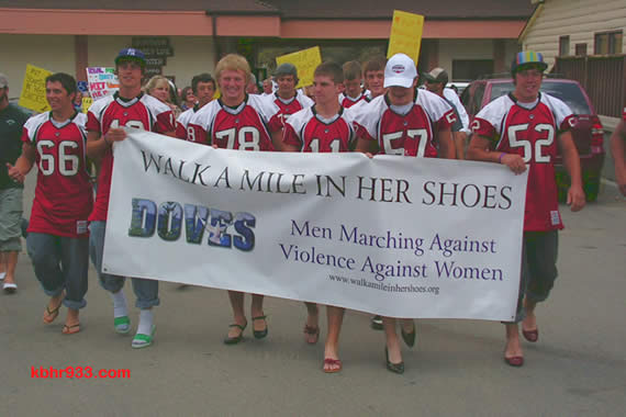 """The Big Bear High School Bears of the varsity football team led the 2008 """"Walk a Mile in Her Shoes"""" march through the Village, which included 75 men in heels."""