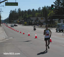 Kevin Magdiel, age 17, has an impressive lead in the home stretch of the half-marathon, and ultimately takes second place.