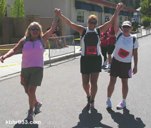 Local teachers Debi Burton, LeighAnne Drake and Alison McPherson celebrate the end of their half-marathon.