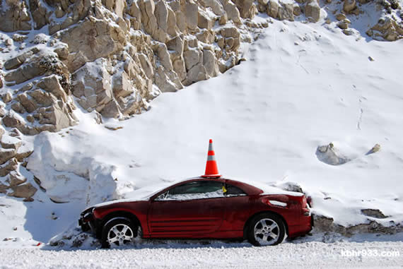 Be sure you are prepared before driving in the mountains in the winter months--unlike this motorist, left stranded in a berm on Arctic Circle last winter. (Photo courtesy Matt Stroud)