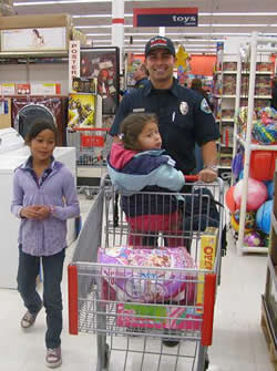 Big Bear City firefighter Jon Bidwell spent some time in the toy aisle with local children yesterday.