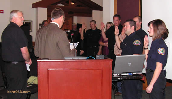 Prior to passing the gavel to Liz Harris, outgoing Mayor Rick Herrick did the swearing in of new paid call firefighters Jared Cheek, Jenny Plumhoff, Brian Geary, Brandon Draucker and Carl Birkholm.