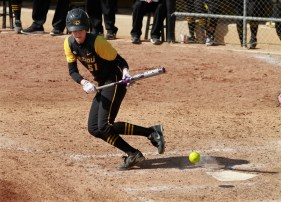Sami Fagan watches as the ball bounces in front of home plate. She had one hit and an RBI in the game.