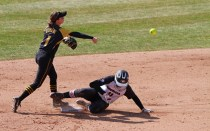 Ashtin Stephens makes the throw to first after putting out Georgia's Kaylee Puailoa at second base.
