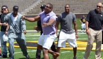 Former MU defensive lineman Michael Sam does his signature sack dance in front of the crowd during the MU spring football game on Saturday, April 19, 2014 at Memorial Stadium in Columbia, Mo. Sam made headlines in February when he came out as openly gay and could be the first openly gay active NFL player if drafted in May.