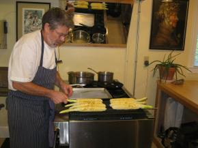 Kevin grills the corn for elote.