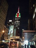 The Empire State Building drenched in Christmas colors.
