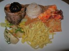 A mixed seafood plate, including lobster and scallops, with a little veal to make it surf and turf.and