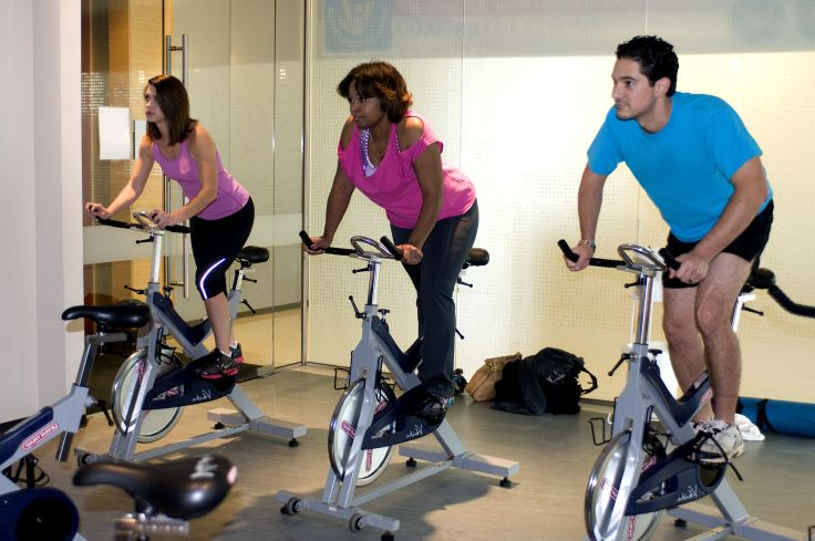 Cycling working out in gym
