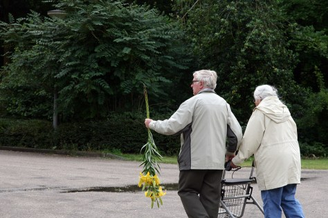 Visitors leave the demonstration with lilies