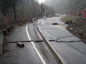 A slow moving slide on Highway 42 at the Coos-Douglas County line has shifted the roadway several feet, moving the guard rail posts, but leaving the guard rail intact. (Oregon Department of Transportation photo)