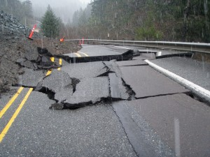 As the hillside above slowly moves, it breaks up the asphalt in the roadway. (ODOT photo)