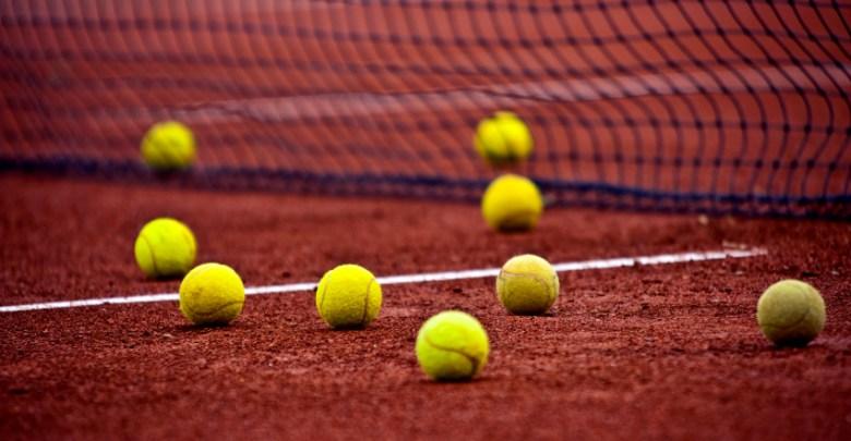 Tennis balls on a court. File photo.