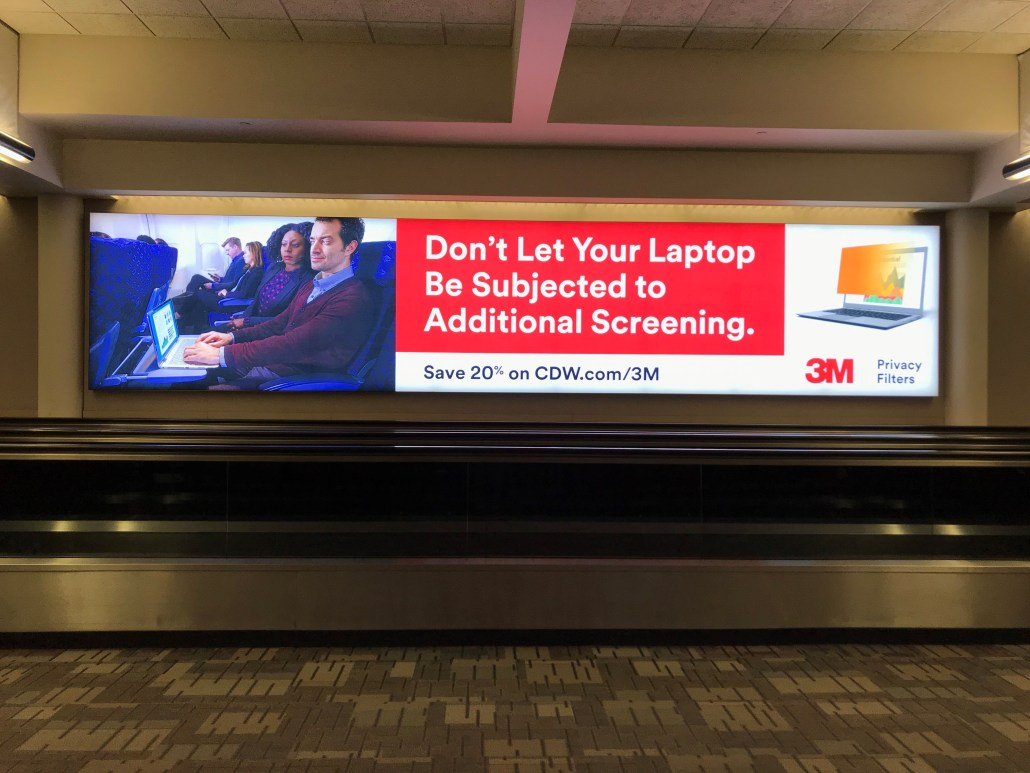"Photo of a 3M Privacy Airport Display with the headline ""Don't let your laptop be subjected to Additional Screening"""