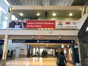 "Photo of a 3M Privacy Airport Banner with the headline ""Leave visual hackers at the Gate"""