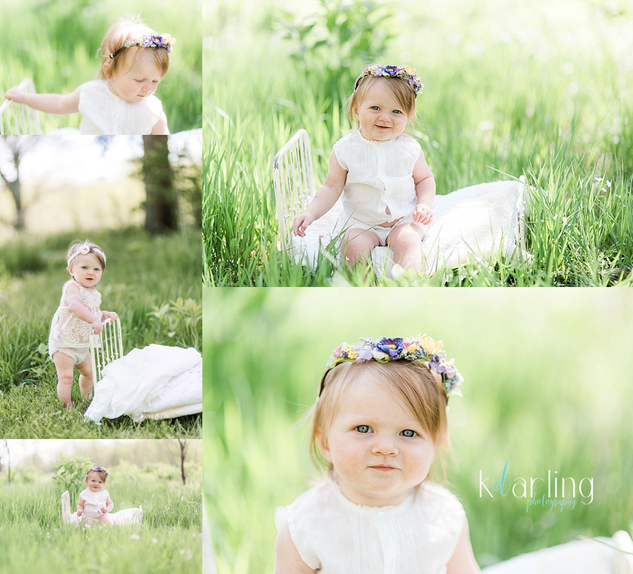 Baby girl in a floral crown and antique dress