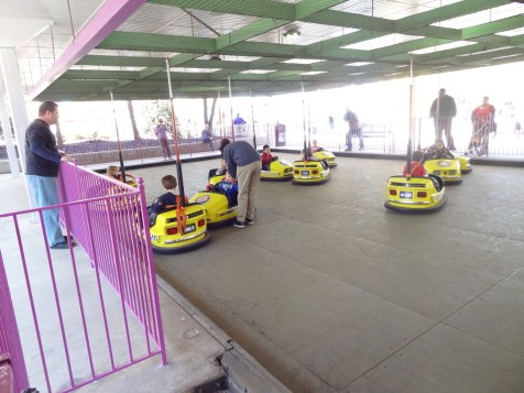 The bumper carts are painted like taxi cabs