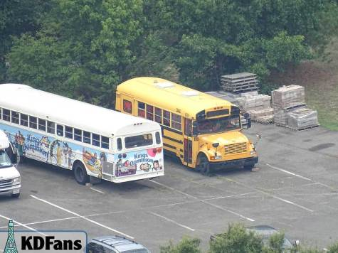 The bus parked in the employee lot