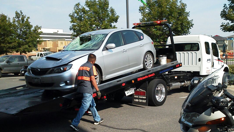 Lakewood Police impound a Subaru Impreza belonging to Catherine Bean, which police believe was involved in a hit-and-run accident that left a cyclist seriously injured on Aug. 22, 2012