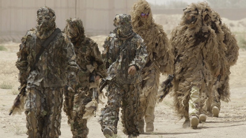 Special operations soldiers don Ghillie suits -- camouflage outfits designed to resemble heavy foliage -- in Iraq. (CNN)