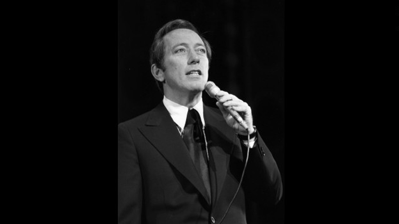 """Andy Williams rehearses at the London Palladium before a Royal Variety Performance in 1970. The smooth-voiced crooner was known for such classics as """"Moon River."""" (CNN)"""