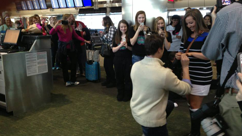 James Monsey proposing to his girlfriend of four years, Liz Robertson at Denver International Airport Thursday Feb. 13, 2014.