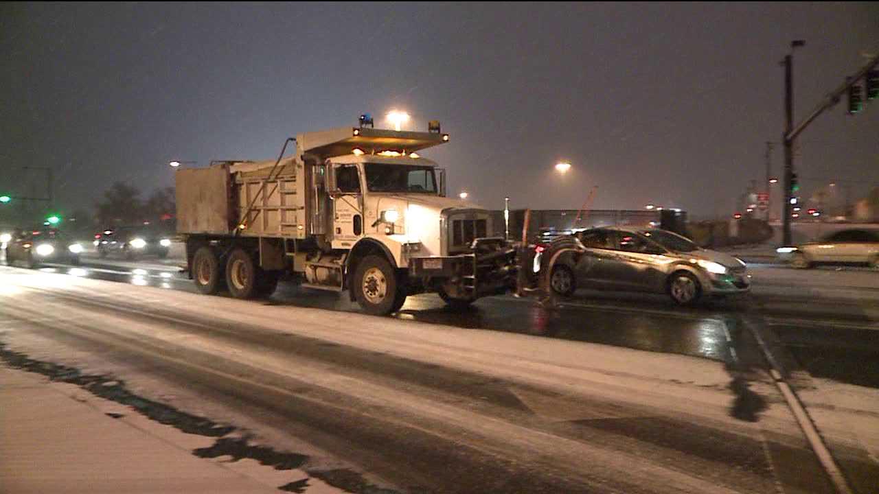 Snowplow helps deice roads. Feb. 25, 2014